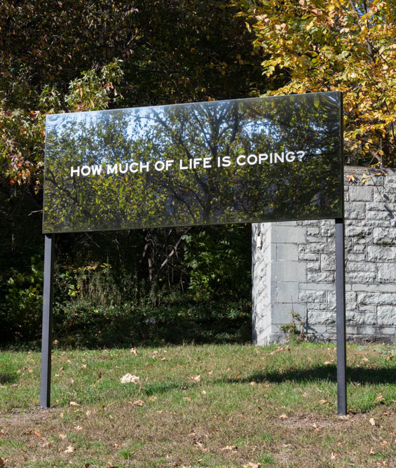How much of life is coping stated on mirrored billboard in St Nicholas Park