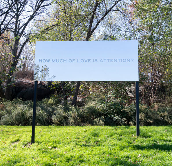 How Much of Love is Attention on mirrored billboard